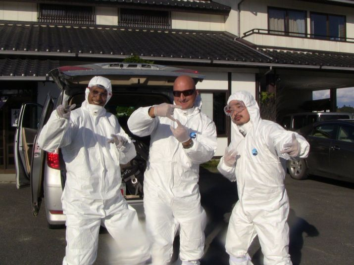 the intrepid crew in radiation proof gear